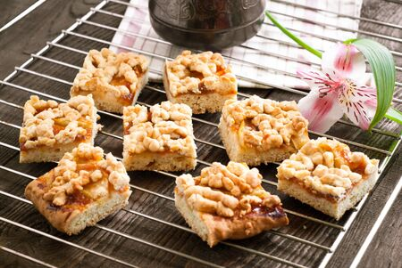 tinting: A few pieces of pie with apples and apricot jam on a baking and coffee pot. Image tinting Stock Photo
