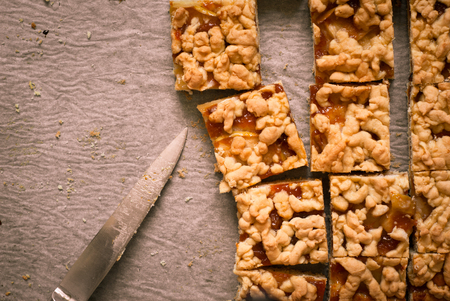 tinting: Pie with apples and apricot jam cut into pieces on a baking. Image tinting