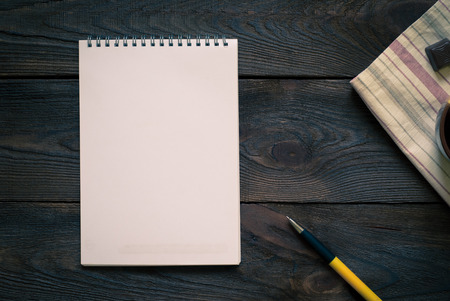 tinting: Notebook to write recipes on the wooden table. Image tinting