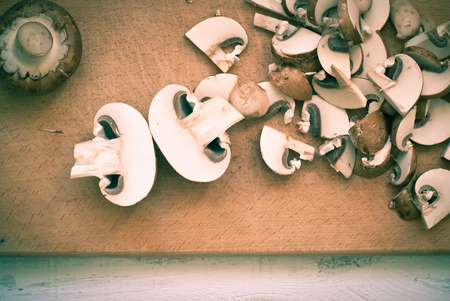 tinting: Mushrooms,  sliced on a cutting board. Ingredients for cooking. Image is tinting.