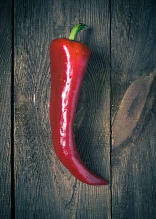 tinting: sweet red pepper on a wooden table. Image tinting
