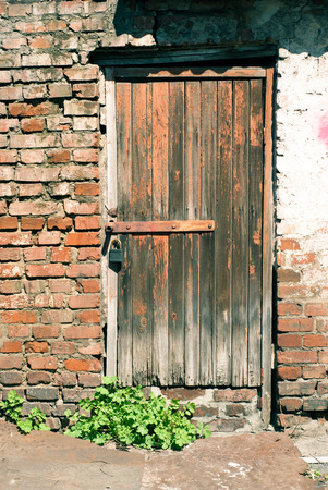 reside: Old wooden door - entrance to the poor house