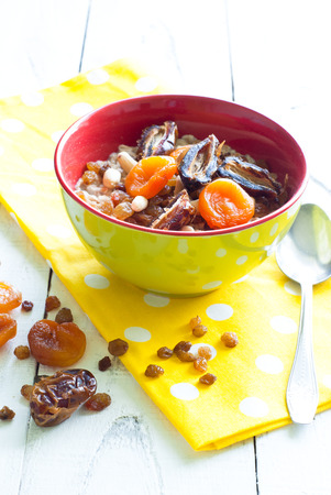 Oatmeal with dried fruit. A fresh and healthy breakfast photo