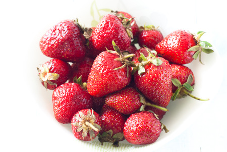 flavorful: Fresh flavorful strawberries on white. Selective focus.