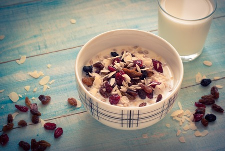 dates fruit: Healthy Breakfast - Oatmeal with dried fruit and glass of milk.