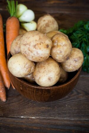 bawl: Fresh vegetables at the wooden table Stock Photo