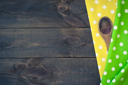 tinting: Wooden table with spoon and  a tablecloth. Top view. Image tinting Stock Photo