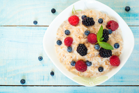 healthy meals: Healthy breakfast - oatmeal with blackberries, blueberries and raspberries Stock Photo