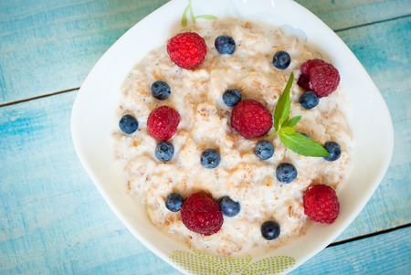 Healthy breakfast - oatmeal with  blueberries and raspberries Stock Photo