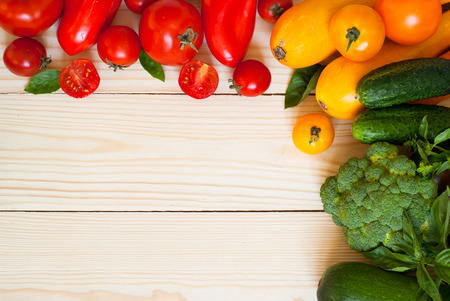 text space: Organic food background- fresh vegetables at wooden table. Free space for your text Stock Photo