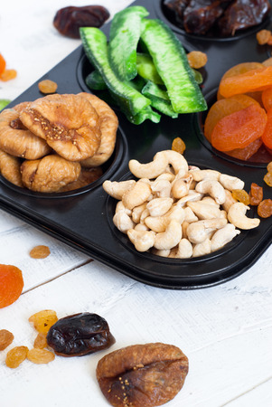 dried fruits: Dried fruits in the form of cakes - dried apricots, dates, figs, papaya, rasins and cashews
