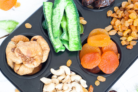 bawl: Dried fruits in the form of cakes - dried apricots, dates, figs, papaya, rasins and cashews