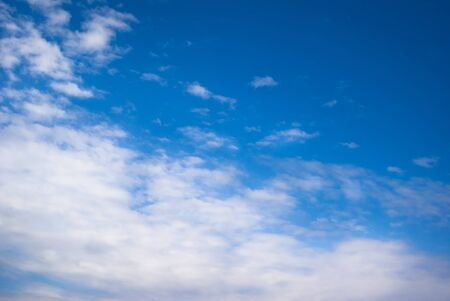 adjective: Blue Sky with clouds Stock Photo