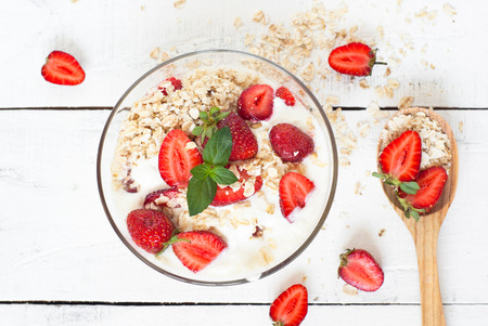 healthy foods: Healthy foods. Homemade yogurt with strawberry and oatmeal.
