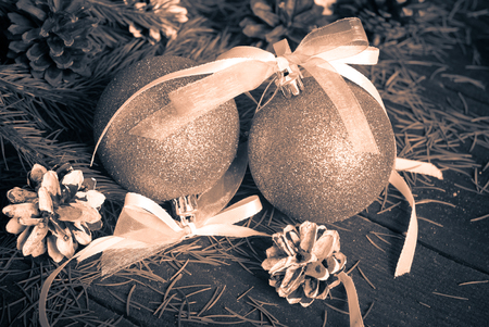 tinting: Christmas decorations with pine cones, balls and spruce branch. Image tinting in retro style, Stock Photo