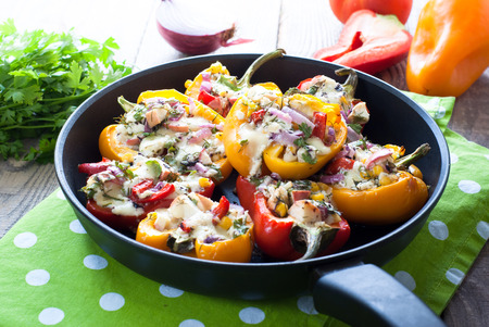 filled: Pepper stuffed with white cheese, greens, onions, corn and apples. Stock Photo