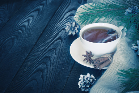 cope: Winter black tea with spices and christmas toys. Cope space.