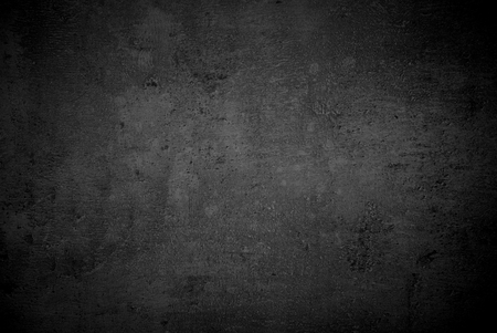 black stones: Abstract dark monochrome background for design. Copy space.