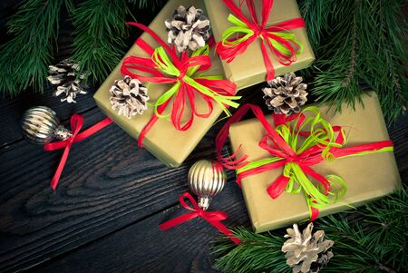 spruce tree: Several boxes of gifts wrapped in paper and decorated with ribbons. Top view. Stock Photo