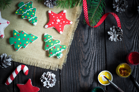 crafted: Hand crafted christmas toys. Salted cookies painted different colors. Top view, copy space. Stock Photo