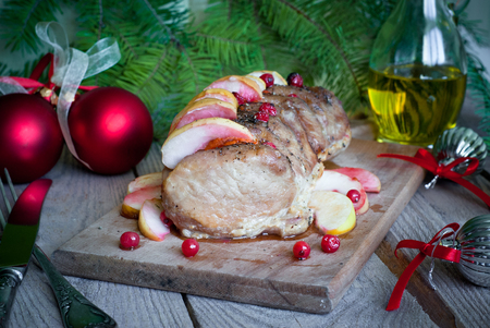 Christmas dish - roast pork with apples and cranberries.