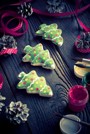 tinted: Handmade Christmas decorations. Salted biscuits painted colors. Image tinted.