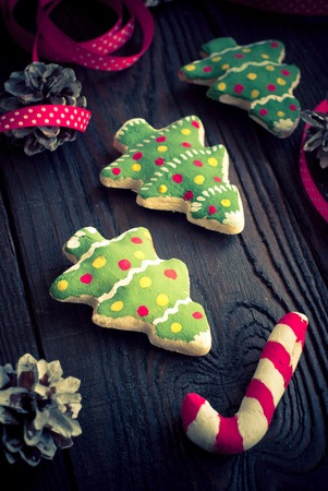 tinted: Handmade Christmas decorations. Salted biscuits painted colors. Image tinted. Selective focus.
