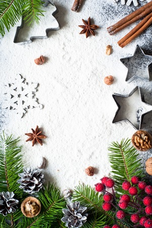 cookie cutters: Ingredients for christmas baking - flour, spices and cookie cutters.