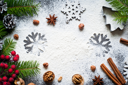 Ingredients for christmas baking - flour, spices and cookie cutters.