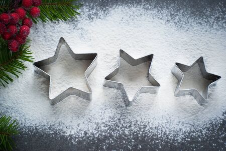 cutters: Baking christmas background with flour and cookie cutters