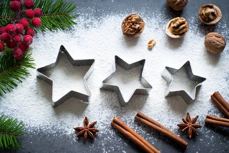 cookie cutters: Baking christmas background with flour, spices and cookie cutters
