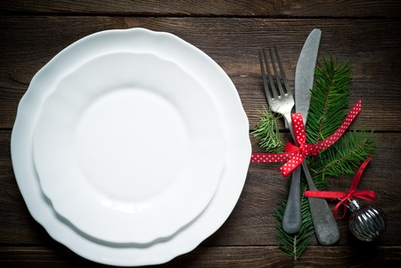 dinner plate: Christmas table setting with silverware and christmas decorations. Stock Photo