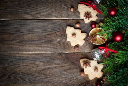 christmas cooking: Christmas baking concept -  some cookies, fir tree brunches and decorations. Top view, copy space