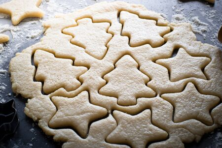 cookie cutters: Baking Christmas cookies -  dough on the table, cookie cutters and cookies.