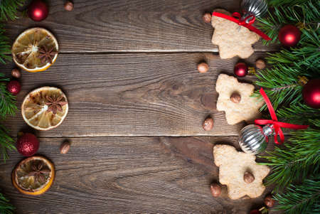 brunches: Christmas baking concept -  some cookies, fir tree brunches and decorations. Top view, copy space