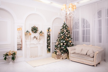 Classic Interior room decorated in Christmas style with Christmas tree and gifts Archivio Fotografico