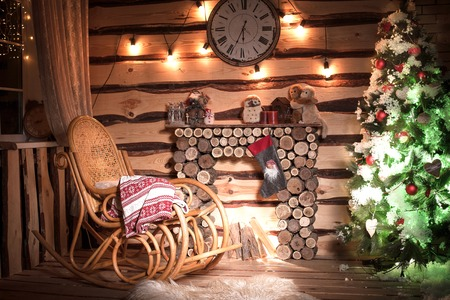 Wooden Interior room decorated in Christmas rustic style.
