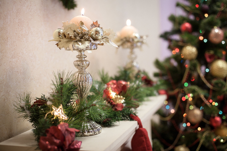 mantelpiece: Candlestick decorated in Christmas style on the mantelpiece. Stock Photo