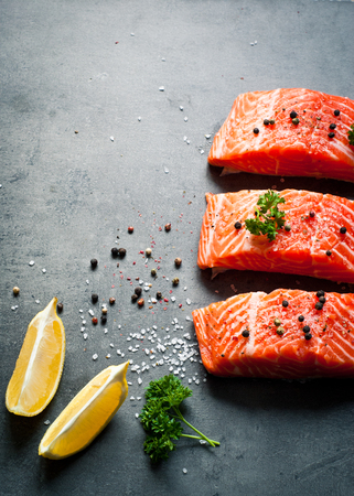 fresh meat: Raw Fillet of salmon with sea salt and pepper. Fresh fish. Top view, copy space. Stock Photo