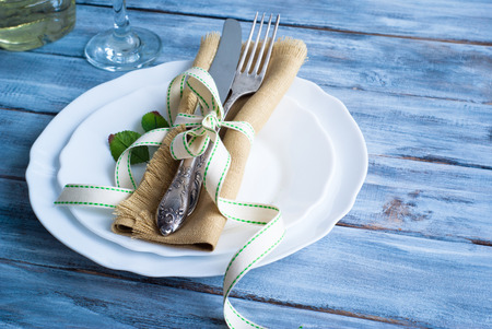 Spring Table setting at wooden table with tape.