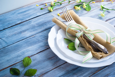 Spring Table setting at wooden table. Copy space.