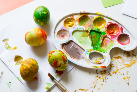 piddle: Childrens creativity. The abstract colored painted eggs for Easter. Stock Photo
