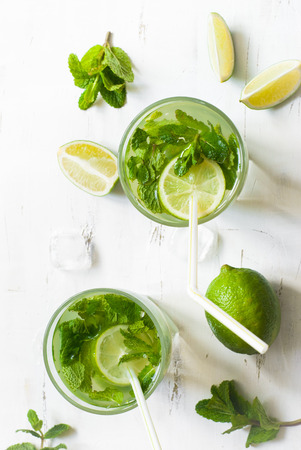 lime slice: Tradition Summer drink mojito with lime and mint. Top view with copy space. Stock Photo