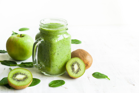 Healthy green smoothie and ingredients on white - spinach, apple and kiwi. Reklamní fotografie
