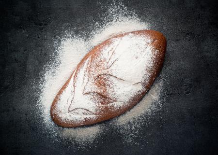 whole grain: Homemade whole grain bread on a dark background.