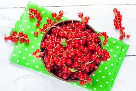 red currants: Fresh berries red currants in the wooden bowl. Stock Photo