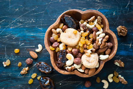 frutas secas: A Mix of variety nuts and dry fruits in a wooden bowl. Foto de archivo