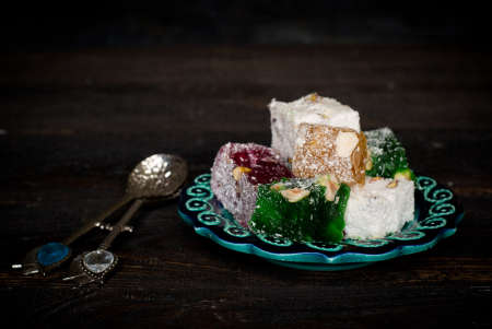 locum: Traditional Turkish sweets delight in traditional handmade ceramic dishes. Stock Photo