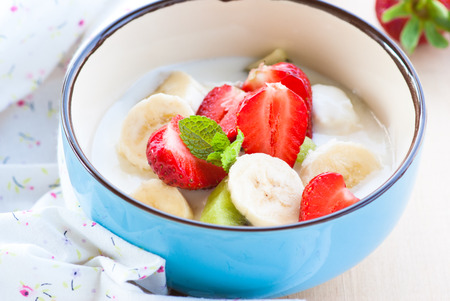 bawl: Healthy breakfast - curd with yogurt fruits and berries. Selective focus, close-up. Stock Photo