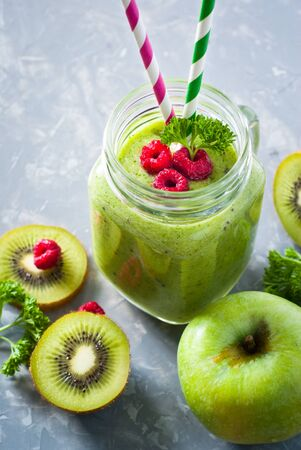 light slate gray: Green smoothie. Smoothie from apple, spinach and kiwi in a mason jar.